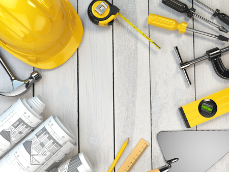 construction helmet: Construction tools on a wooden background. Hard helmet,  trowel, drawing and level with space for text. 3d illustration