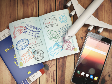 Travel and tourism concept. Passport with visas and boarding passes, airplane and mobile on the wood table. 3d illustration Imagens