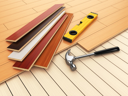 decorating: Laying hardwood parquet concept. Hammer and level on the floor. 3d illustration