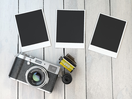 photo pictures: Retro camera, empty photo frames pictures and film canisterrs  on wood table. 3d illustration Stock Photo