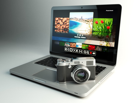 viewer: Photo camera and laptop with image viewer on the screen. Digital photography workstation concept. 3d illustration