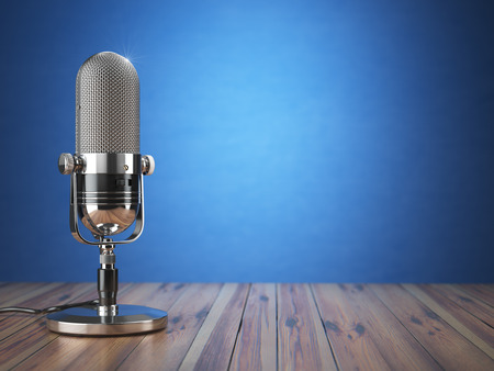 Retro old microphone. Radio show or audio podcast concept. Vintage microphone on blue background. 3d illustration