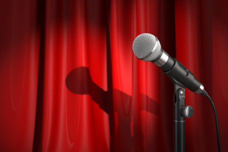 stage performance: Microphone on stage with red curtain. Music or performance  concept.. 3d illustration