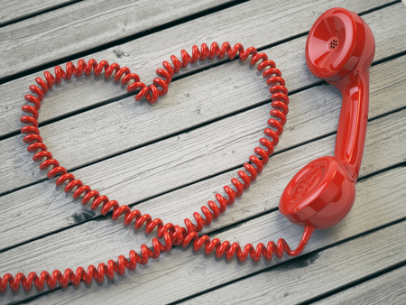 reciever: Phone reciever and cord as heart on white wooden background. Love hotline concept. 3d illustration