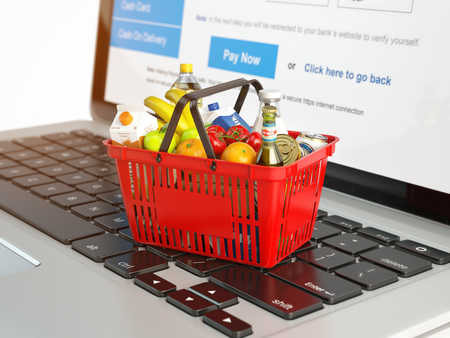 ion: Shopping basket with variety of grocery products ion laptop keyboard. E-commerce concept 3d illustration