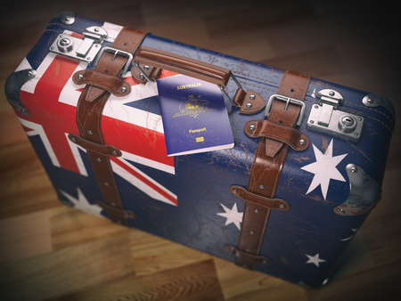 Passport of Australia and suitcase with flag of Australia. Travel or immigration concept.3d illustration Stockfoto