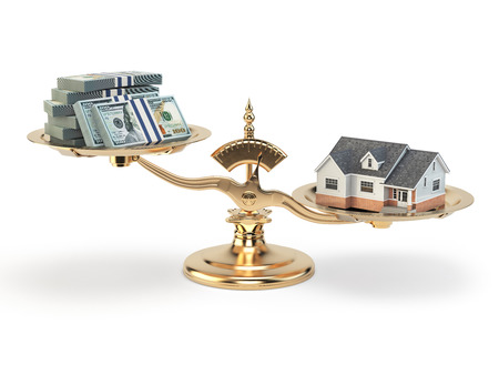 condominium: Scales with house and money. Real estate investments concept.