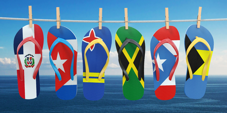 Hanging flip flops in colors of flags of different carribean countries Aruba, Bahamas, Cuba, Dominicana, Jamaica, Puerto-Rico. Travel and tourism concept. 3d illustration Stock Photo