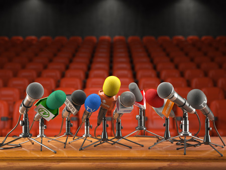 Press conference or interview event concept. Microphones  of different mass media, radio, tv in conference hall with red seating for spectators. 3d illustration Stock Photo