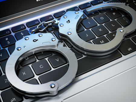 Handcuffs on the laptop keyboard. Internet cyber crime, hacking and online piracy concept. 3d illustration 스톡 콘텐츠