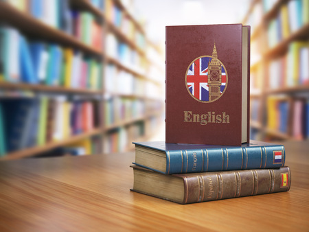 Learn English concept. English dictionary book or textbok with flag of Great Britain and Big ben tower on the cove in the library. 3d illustration Stock Photo