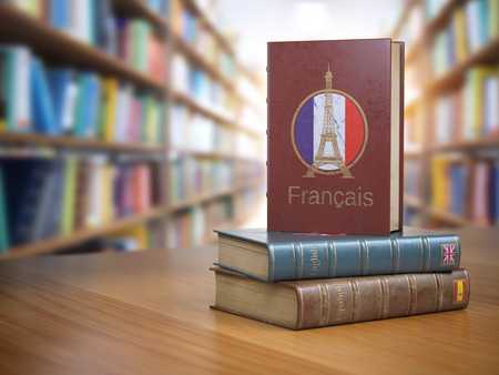 Learn French concept. French dictionary book or textbok with flag of France and Eiffel tower on the cover in the library. 3d illustration Stock Photo