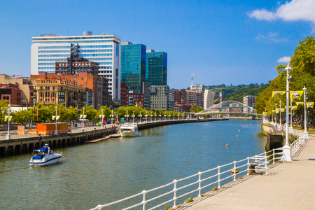 View of Bilbao, Downtown with a Nevion River, Zubizuri Bridge and promenade. Basque country. Spain