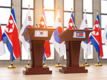 North Korea and South Korea deal c ooperation partnership and relationship. Flags of the North Korea and South Korea and tribunes at international meeting or press conference. 3d illustration