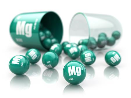 Capsula con elemento di magnesio Mg. Supplementi dietetici. Capsula di vitamina isolata su bianco. illustrazione 3D Archivio Fotografico