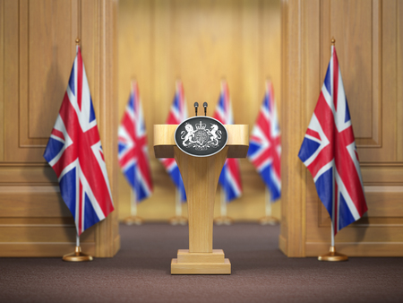 Briefing of prime minister or queen of UK  Great Britain. Podium speaker tribune with flags of Great Britain and UK coat of arms. Politics concept. 3d illustration Stock Photo