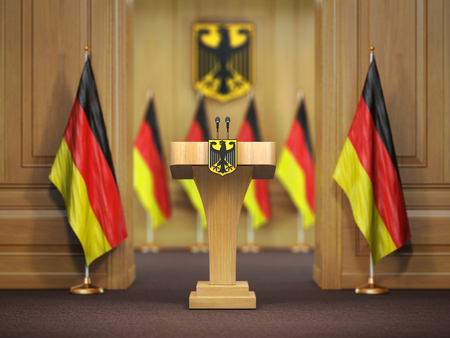 Press conference or briefing of premier minister of Germany concept,. Podium speaker tribune with Germany flags and coat arms. 3d illustration Stock Photo