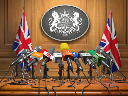 Briefing or press conference of prime minister or queen of UK  Great Britain. Microphones with flags of Great Britain and UK coat of arms. 3d illustration