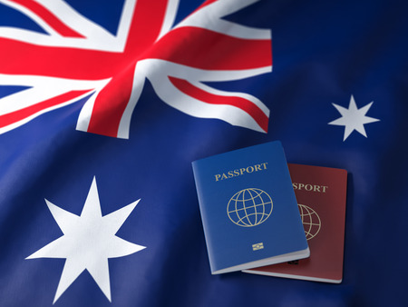 Travel, tourism  or immigration in Australia concept. Different passports on Australian flag.