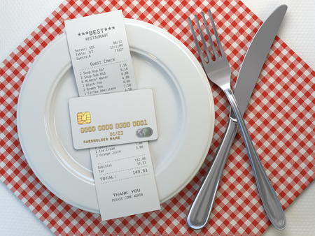 Restaurant  receipt bill  for payment by credit card on the plate Stock Photo