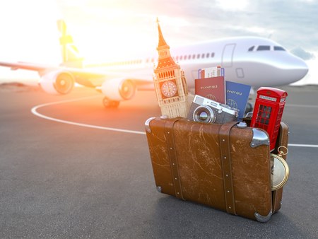 Flight to London, Great Britain.Vintage suitcase with symbols of UK London, Big Ben and red booth. Travel and tourism concept. Stock Photo