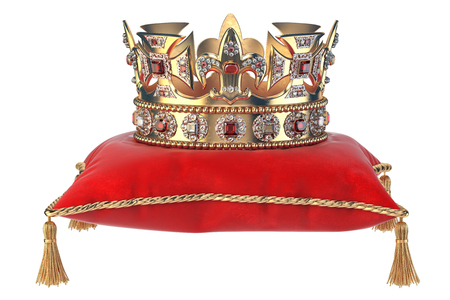 Golden crown with jewels on red velvet pillow for coronation isolated on white.