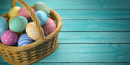 Easter eggs in a basket on the green wooden planks.