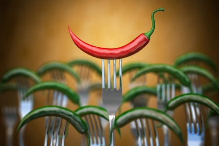 Red hot chili pepper stuck on the fork Stock Photo