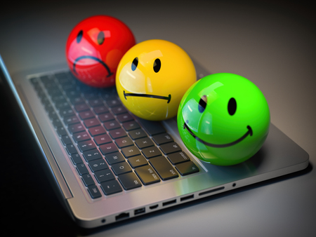 Customer satisfaction h feedback rating concept. Colored smile emoticons on laptop keyboard. 3d illustration