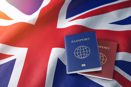 Passports on the flag of the Australia. Getting a visa to Australia ,  travel, naturalization and immigration concept. 3d illustration Stok Fotoğraf - 118850532