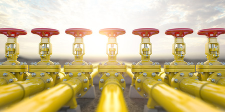 Yellow gas pipe line valves. Oil and gas extraction, production and transportation industrial Archivio Fotografico