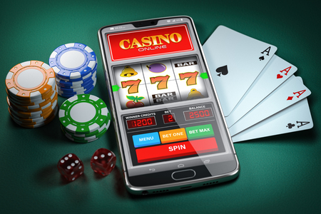 Online casino and gambling concept. Slot machine on smartphone screen, cards, dice and poker chips.