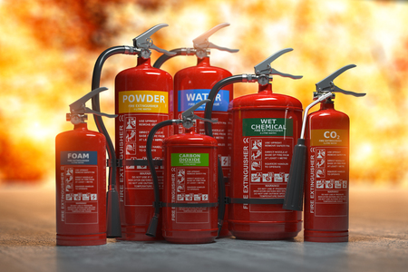 Fire extinguishers on a fire 스톡 콘텐츠