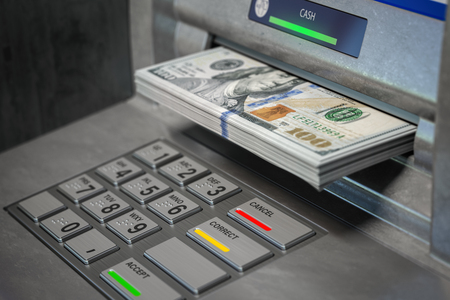 ATM machine and dollars.
