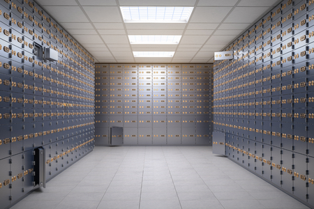 Safe deposit boxes room inside of a bank vault.