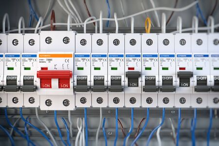 Automatic circuit brakers in a row. Electric switches in fusebox. 3d illustration