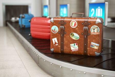 Old vintage suitcase on a airport luggage conveyor belt Standard-Bild
