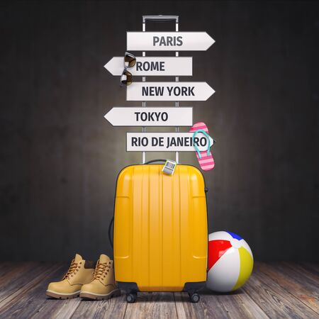 Yellow suitcase and signpost with travel destination