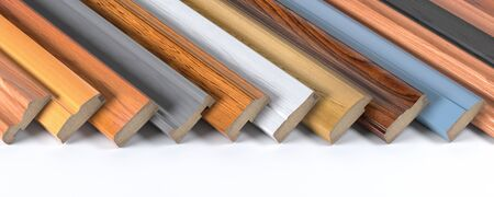Set of wooden furniture CMD or MDF profiles. Samples of baseboards from different types of wood.