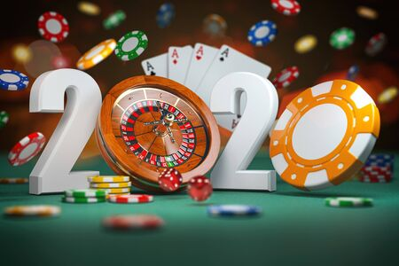 2020 Happy New Year in casino. Numbers 2020 from roulette and casino chips with dice and card on green table. Stock Photo