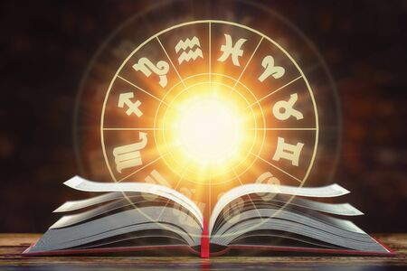 Astrology horoscope concept. Opened book with magic zodiac signs and symbols.