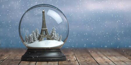 Eiffel tower in the snow globe glass ball. Travel or trip to Paris and France in winter for celebrate Christmas.