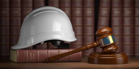 Gavel with construction hard hat and books.
