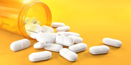 Pills and orange pill bottle on yellow