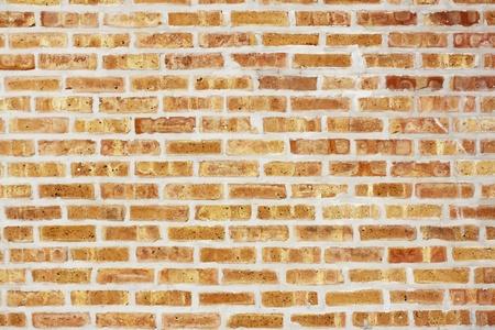 yellow stone: Fondo urbano (pared de ladrillos)