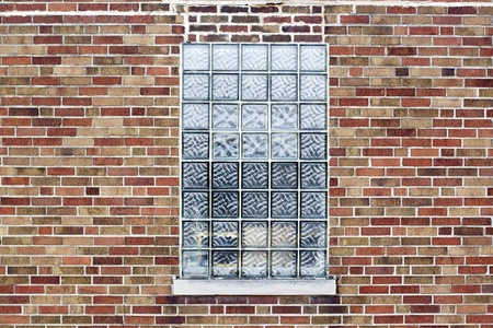 Industrial Color Brick Wall with Blue Glass Block Window photo