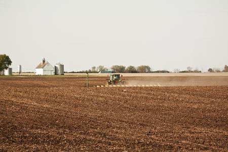 Green Tractor on Farm photo