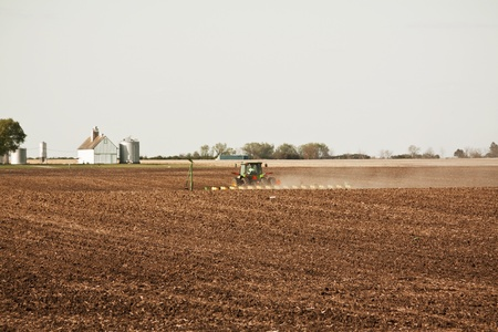 Green Tractor on Farm photo