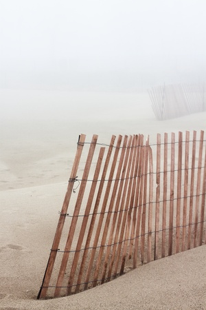 Wooden Beach Fence with fog in background