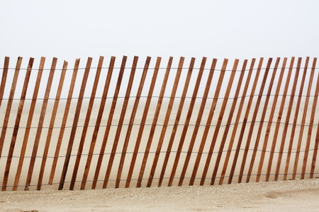 Illusion - Wooden Beach Fence with fog in background